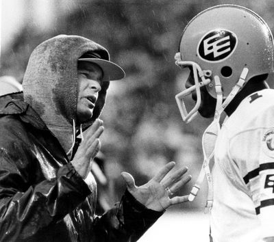 The Edmonton Eskimos head coach Hugh Campbell talks to quarterback Warren Moon on the sidelines during the 70th Grey Cup game (nicknamed the �Rain Bowl�) on Sunday Nov. 28, 1982, at Exhibition Stadium in Toronto, Ont. The Eskimos beat the Toronto Argonauts 32 -16. The Eskimos won the Canadian Football League championship five years in a row, 1978, 1979, 1980, 1981 and 1982. Photo/The Canadian Press