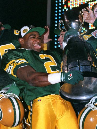 "1993 Grey Cup. Edmonton Eskimos Henry ""Gizmo"" Williams sticks out his tongue as he holds the 81st Grey Cup after the Eskimos beat the Winnipeg Blue Bombers 33-23 in front of 50,035 fans on Sunday Nov. 28, 1993, at McMahon Stadium in Calgary, Alta. Perry Mah/Edmonton Sun/Postmedia Network"