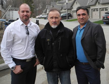 Ryan Campbell (left) of The Crew real estate, with builder Fernando Recchia, of Bevco Homes Ltd., and Kiou Amini, of The Crew real estate, are marketing the new condominium development at 60 Dufferin Ave. primarily to baby boomers. (Vincent Ball, The Expositor)
