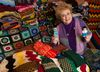 Eileen McCaughey with some of the knitting she has amassed that are donated to various needy people. Friday November 27, 2015. Errol McGihon/Ottawa Sun/Postmedia Network