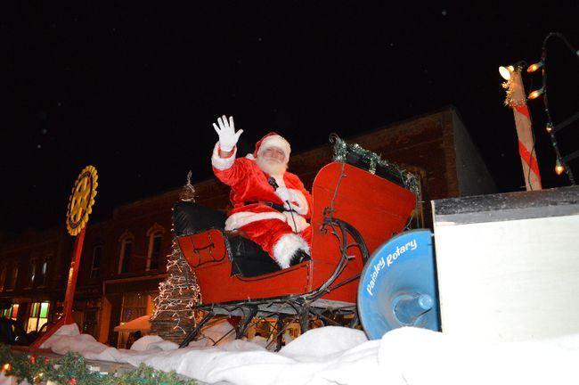 With a hearty Ho Ho Ho Santa Claus greeted the festive throngs of people who lined the downtown of Paisley Nov. 27 for the 25th annual Chamber of Commerce Santa Claus parade.