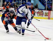 Flint Firebirds Mathieu Henderson battles for the puck with Sudbury Wolves Mikkel Aagaard during first period OHL action in Sudbury, Ont. on Saturday November 28, 2015. Gino Donato/Sudbury Star/Postmedia Network