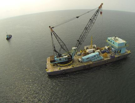 Offshore in Lake Erie, near Cleveland, a crane barge is captured in this drone image from September during work testing the lake bottom for soil stability needed for support bases for industrial wind turbines. Special to Postmedia Network