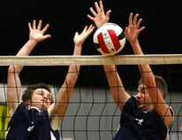 Jayden Herzog and Max Barrs, of the Peace Wapiti Academy Titans jump to try and make a block against the HJ Cody School Sylvan Lake Lakers at the ASAA 3A Boys Volleyball Provincials on Saturday at Peace Wapiti Academy, The Lakers won in two sets (25-14 and 25-20). Logan Clow/Grande Prairie Daily Herald-Tribune/Postmedia Network