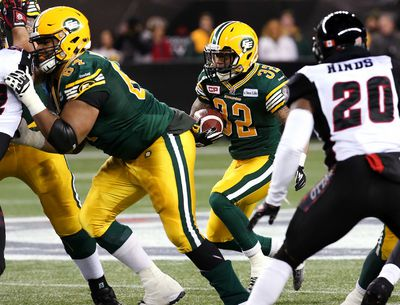 Edmonton Eskimos Kendial Lawrence runs into the line during second quarter action against the Ottawa REDBLACKS in the CFL's 103rd Grey Cup football championship at Investors Group Field in Winnipeg, Man., Sunday November 29, 2015. Al Charest/Calgary Sun/Postmedia Network