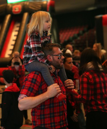 Sunday, Nov. 29, 2015 Ottawa -- A plaid-clad father/daughter duo took in the Grey Cup watch party  at the TD Place arena on Sunday, Nov. 29, 2015.  Chris Hofley/Ottawa Sun