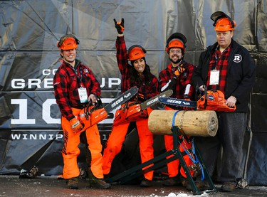 """Members of the Ottawa Redblack's """"Chainsaw Squad,"""" pose on the sidelines prior to the the CFL's 103rd Grey Cup championship football game between the Redblacks and the Edmonton Eskimos in Winnipeg, Manitoba, November 29, 2015. REUTERS/Mark Blinch"""