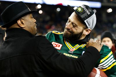 Edmonton Eskimos quarterback Mike Reilly and team General Manager Ed Hervey enjoy a moment after the Eskimos beating the Ottawa REDBLACKS 26-20 to win the CFL's 103rd Grey Cup football championship at Investors Group Field in Winnipeg, Man., Sunday November 29, 2015. Al Charest/Calgary Sun/Postmedia Network