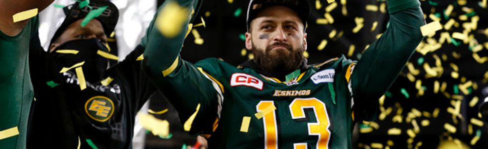 Edmonton Eskimos quarterback Mike Reilly lifts the Grey Cup over his head as he celebrates beating the Ottawa REDBLACKS in the CFL's 103rd Grey Cup football championship at Investors Group Field in Winnipeg, Man., Sunday November 29, 2015. Al Charest/Calg