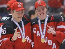Curtis Lazar #26 and Connor McDavid #17 of Team Canada wear their gold medals with pride after defeating Team Russia in the Gold medal game in the 2015 IIHF World Junior Hockey Championship at the Air Canada Centre on January 5, 2015 in Toronto, Ontario,