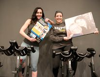 Janine Hartsook and Tammy Block pose for a photo at PUSH Cycling Studio. The friends will be joined by eight other teammates to participate in the Ride to Conquer Cancer next August.