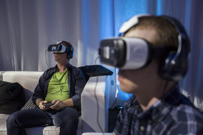 Guests use Gear VR virtual reality headsets during a preview session in Hollywood, California September 24, 2015. (REUTERS/Mario Anzuoni)