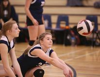 Jessie Toth prepares to hit the ball during a season game. The St. Martin de Porres Kodiaks senior girls volleyball team had a disappointing 3A provincial tournament in Bonnyville last weekend, losing all five of their games. AIRDRIE ECHO FILE PHOTO