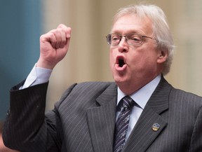 Quebec Health Minister Gaetan Barrette responds to the Opposition, during question period,Tuesday, December 1, 2015 at the legislature in Quebec City. The Quebec government will seek leave to appeal a court ruling that would postpone the implementation of a provincial law on assisted dying. Barrette reiterated his belief that the law is valid. THE CANADIAN PRESS/Jacques Boissinot