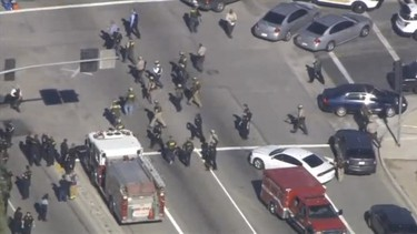 A still image from a video footage courtesy of Nbcla.com shows first responders responding to a shooting at the California Department of Developmental Services Inland Regional Center, one of 21 facilities serving people with developmental disabilities, in San Bernardino, California December 2, 2015. Three people were killed and as many as 20 were wounded on Wednesday when at least one person opened fire at a social services agency in the Southern California city of San Bernardino, authorities and a witness said.   REUTERS/NBCLA.COM/Handout