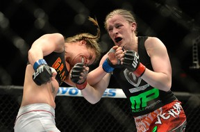 Sarah Kaufman (red gloves) fights Leslie Smith (blue gloves) during their women's bantamweight bout at Colisee Pepsi in Quebec City. (Eric Bolte/USA TODAY Sports)