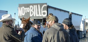 About 50 protesting farmers and ranchers drove tractors, grain trucks and combines to the side of Highway 2 north of Nanton, November 30, 2015. (MIKE STURK/Reuters)
