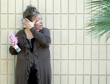 A woman weeps at the Rudy Hernandez Community Center as she waits for a relative who was not injured after a shooting rampage at the Inland Regional Center in San Bernardino, California December 2, 2015.   REUTERS/Alex Gallardo
