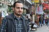 Syrian refugee Khaled Dos, 25, from Busra Alsham, Syria is seen on the streets of Amman, Jordan, Wednesday, December 2, 2015 in Amman. As a single man, Dos's hopes to immigrate to Canada are slim due to a decision by the Canadian government. THE CANADIAN PRESS/Paul Chiasson