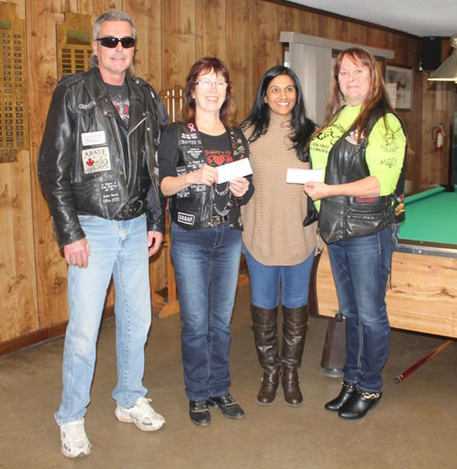 The Association of Bikers for Awareness, Training and Education and the Lake Huron Steel Horse Riders presented Anita Shah of Childcan with $2,200 on Nov. 21. Presenting the cheque were, from left to right, Cuzman, Kimmer, Anita Shah and Brenda Brown. (Laura Broadley/Goderich Signal Star)