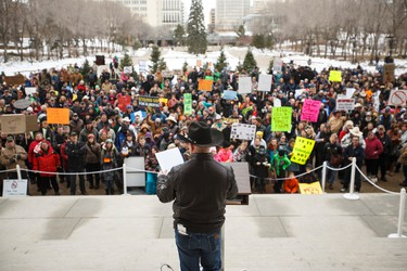 Organizer Travis Olson speaks during an anti-Bill 6 rally put on by the Wildrose Party in front of the Alberta Legislature in Edmonton, Alta., on Thursday, December 3, 2015. Bill 6, the Enhanced Protection for Farm and Ranch Workers Act, has proven controversial with farmers and ranchers in the province. Ian Kucerak/Edmonton Sun/Postmedia Network