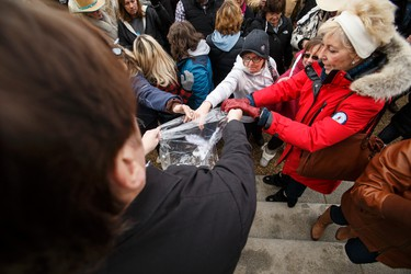 George Clark (left) gathers protest feathers during an anti-Bill 6 rally put on by the Wildrose Party in front of the Alberta Legislature in Edmonton, Alta., on Thursday, December 3, 2015. Bill 6, the Enhanced Protection for Farm and Ranch Workers Act, has proven controversial with farmers and ranchers in the province. Ian Kucerak/Edmonton Sun/Postmedia Network