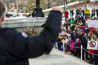 PC MLA Dave Rodney shakes his fist during an anti-Bill 6 rally put on by the Wildrose Party in front of the Alberta Legislature in Edmonton, Alta., on Thursday, December 3, 2015. Bill 6, the Enhanced Protection for Farm and Ranch Workers Act, has proven controversial with farmers and ranchers in the province. Ian Kucerak/Edmonton Sun/Postmedia Network