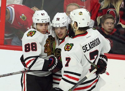 Chicago Blackhawks' Artemi Panarin (72) celebrates his goal against the Ottawa Senators with teammates Patrick Kane (88) and Brent Seabrook (7) during second period NHL action in Ottawa Thursday, December 3, 2015. THE CANADIAN PRESS/Fred Chartrand