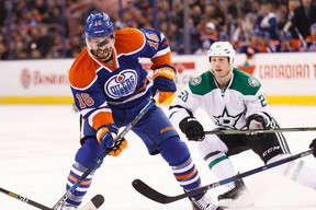 Edmonton forward Teddy Purcell (16) battles Dallas centre Cody Eakin (20) for the puck during the first period of a NHL game between the Edmonton Oilers and the Dallas Stars at Rexall Place in Edmonton, Alta. on Friday December 4, 2015. Ian Kucerak/Edmonton Sun/Postmedia Network