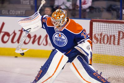 Edmonton goaltender Cam Talbot (33) makes a save during warmup before a NHL game between the Edmonton Oilers and the Dallas Stars at Rexall Place in Edmonton, Alta. on Friday December 4, 2015. Ian Kucerak/Edmonton Sun/Postmedia Network