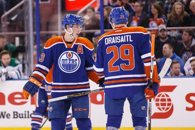 Edmonton centre Ryan Nugent-Hopkins (93) and centre Leon Draisaitl (29) speak before a faceoff during the first period of a NHL game between the Edmonton Oilers and the Dallas Stars at Rexall Place in Edmonton, Alta. on Friday December 4, 2015. Ian Kucerak/Edmonton Sun/Postmedia Network