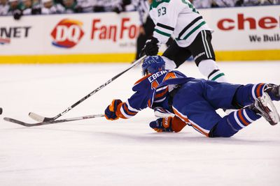 Edmonton forward Jordan Eberle (14) dives for a puck past Dallas forward Ales Hemsky (83) during the first period of a NHL game between the Edmonton Oilers and the Dallas Stars at Rexall Place in Edmonton, Alta. on Friday December 4, 2015. Ian Kucerak/Edmonton Sun/Postmedia Network