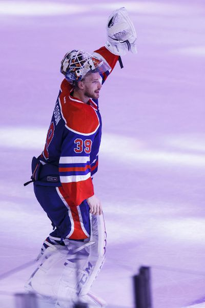 Edmonton goaltender Anders Nilsson (39) salutes the crowd after being named the top star of the game after the Oilers beat the Dallas Stars 2-1 at Rexall Place in Edmonton, Alta. on Friday December 4, 2015. Ian Kucerak/Edmonton Sun/Postmedia Network