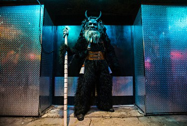 Krampus poses in a doorway during the Krampuslauf along Whyte Avenue in Edmonton, Alta., on Saturday, Dec. 5, 2015. In German-speaking countries, Krampus is a horned yule lord who punishes children who have misbehaved. Traditional Krampuslauf parades are held every December. Codie McLachlan/Edmonton Sun/Postmedia Network
