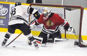 Brock Baier, goalie with the Mitchell Hawks, recorded this save on a penalty shot by Goderich Flyers' Noah Kuno, late in the first period Sunday, Dec. 6. Baier stopped all the shots in the two periods he played, and his teammates had no trouble finding the net at the other end in a 12-0 victory. ANDY BADER/MITCHELL ADVOCATE