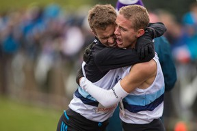 Kingston Collegiate runners Ben Workman, left, and Cam Linscott embrace after the senior boys race at the Ontario Federation of School Athletic Associations cross-country championships in 2014. Linscott won the race and Workman finished third.