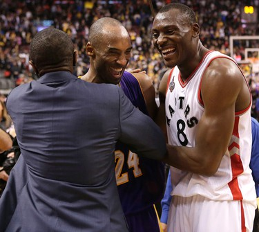 Raptors coach Dwane Casey and Bismack Biyombo  hug Los Angeles Lakers Kobe Bryant after Bryant plays last game at the ACC in Toronto, Ont. on Monday December 7, 2015. Craig Robertson/Toronto Sun/Postmedia Network