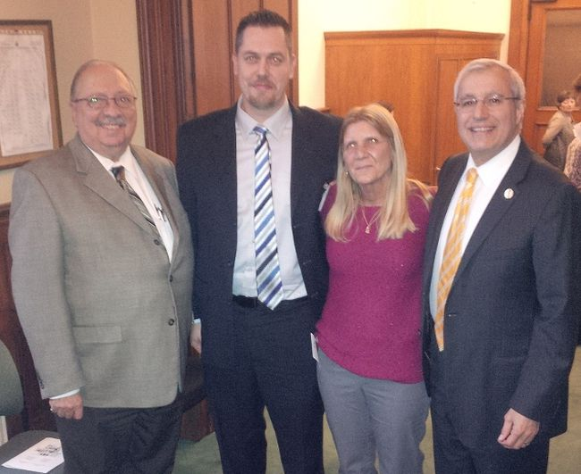 Sarnia-Lambton MPP Bob Bailey, left, stands with Patch for Patch program proponents Mike Howell, Laurie Hicks, and Nipissing MPP Vic Fedeli. Queen's Park voted to make the fentanyl patch exchange program law Monday with all-party support. (Handout/Sarnia Observer/Postmedia Network)