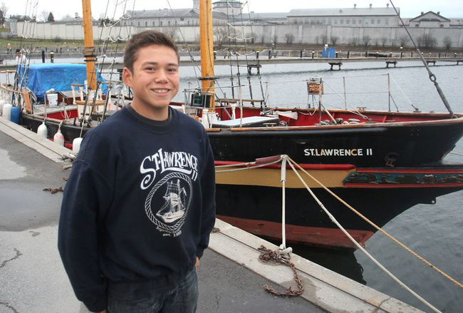 Saimaniq Temela, standing in front of the St. Lawrence II in Kingston, recently went on a three-week sail training voyage in the Arabian Gulf. (Michael Lea/The Whig-Standard)