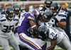 Vikings running back Adrian Peterson (28) is stopped by Seahawks defenders during NFL action in Minneapolis on Dec. 6, 2015. The Cardinals play the battered Vikings on Thursday in Arizona. (Ann Heisenfelt/AP Photo)