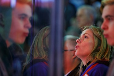 Fans sing the national anthem before the first period of a NHL game between the Edmonton Oilers and the San Jose Sharks at Rexall Place in Edmonton, Alta. on Wednesday December 9, 2015. Ian Kucerak/Edmonton Sun/Postmedia Network
