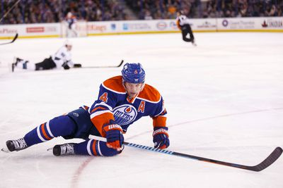 Edmonton forward Taylor Hall (4) slides across the ice during the first period of a NHL game between the Edmonton Oilers and the San Jose Sharks at Rexall Place in Edmonton, Alta. on Wednesday December 9, 2015. Ian Kucerak/Edmonton Sun/Postmedia Network