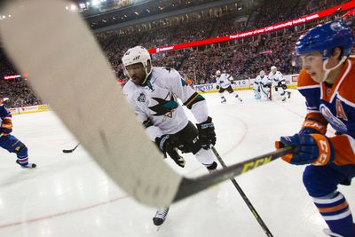 Edmonton centre Ryan Nugent-Hopkins (93) and San Jose forward Joel Ward (42) chases the puck during the first period of a NHL game between the Edmonton Oilers and the San Jose Sharks at Rexall Place in Edmonton, Alta. on Wednesday December 9, 2015. Ian Kucerak/Edmonton Sun/Postmedia Network