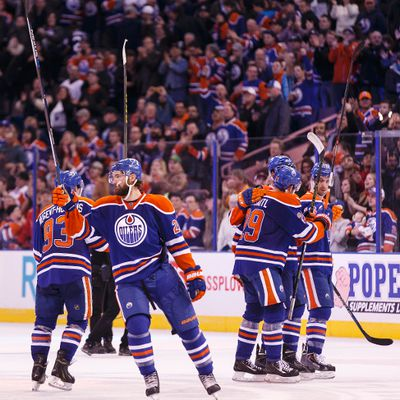 Edmonton players salute the crowd at the end of a NHL game between the Edmonton Oilers and the San Jose Sharks at Rexall Place in Edmonton, Alta. on Wednesday December 9, 2015. The Oilers won 4-3 in overtime. Ian Kucerak/Edmonton Sun/Postmedia Network