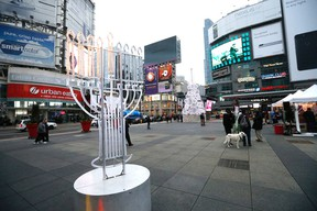 A menorah and a Christmas tree are part of the decorations at a the Yonge-Dundas Square on Thursday December 10, 2015. Michael Peake/Toronto Sun