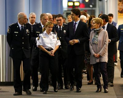 Canada's Prime Minister Justin Trudeau (2nd R) arrives with Ontario Premier Kathleen Wynne (R) to await Syrian refugees at the Toronto Pearson International Airport in Mississauga, Ontario, December 10, 2015. After months of promises and weeks of preparation, the first planeload of Syrian refugees was headed to Canada on Thursday, aboard a military plane to be met at Toronto's airport by Trudeau. REUTERS/Mark Blinch
