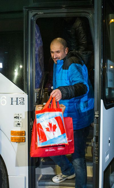Syrian refugees arrive by bus to a hotel on Dixon Rd. near Toronto Pearson International Airport in Toronto, Ont.  on Friday December 11, 2015. Ernest Doroszuk/Toronto Sun/Postmedia Network