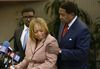 Attorney John Burris, right, comforts Gwen Woods, the mother of Mario Woods, the a knife-wielding stabbing suspect who was fatally shot by San Francisco Police last week, at a news conference at Southeast Community College in San Francisco, Friday, Dec. 11, 2015. (AP Photo/Jeff Chiu)