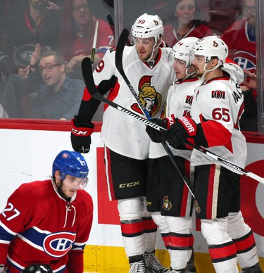 Dec 12, 2015; Montreal, Quebec, CAN; Ottawa Senators center Jean-Gabriel Pageau (44) celebrates his goal against the Montreal Canadiens with teammates as center Alex Galchenyuk (27) passes on during the second period at Bell Centre. Mandatory Credit: Jean-Yves Ahern-USA TODAY Sports