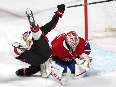 Dec 12, 2015; Montreal, Quebec, CAN; Ottawa Senators right wing Bobby Ryan (6) falls on Montreal Canadiens  goalie Dustin Tokarski (35) during the third period at Bell Centre. Mandatory Credit: Jean-Yves Ahern-USA TODAY Sports